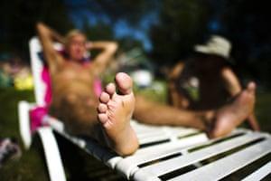 FTA: Mark Blinch: A man relaxes in the sun