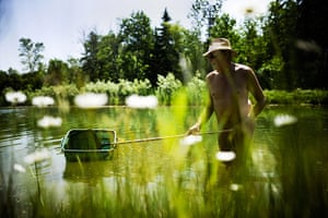 FTA: Mark Blinch: A man carries out maintenance in the pond
