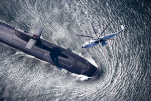 The Sea: A helicopter hovering above a submarine off the coast of Brittany