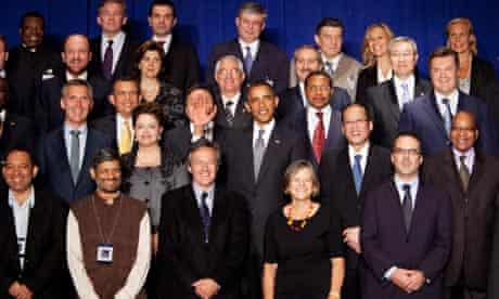 Obama raises his hand in front of another leader at a UN meeting in New York on20 September.
