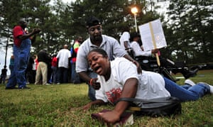 troy davis execution: A protester is helped off the ground