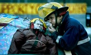 Firefighter with effigy of John Prescott