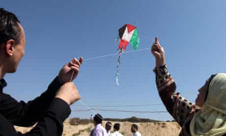 Palestinians fly a kite of their flag in Gaza