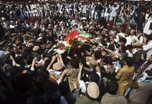 Rabbani funeral: Mourners carry the coffin through a crowd