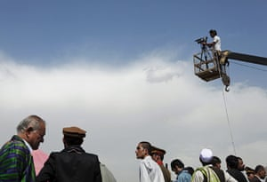 Rabbani funeral: A TV cameraman films the burial ceremony
