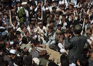 Rabbani funeral: Mourners pray over the grave
