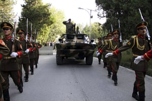 Rabbani funeral: Soldiers march with a military vehicle transporting the coffin