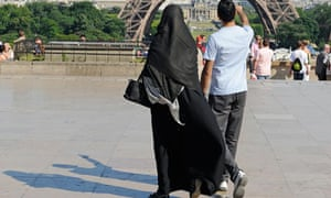 A woman wearing a niqab in Paris before France outlawed such coverings