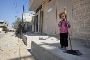 Palestinian Lives: A girl with Broomstick at the Brazil refugee camp, Rafah