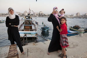 Palestinian Lives: A family enjoy a day at the beach in Gaza