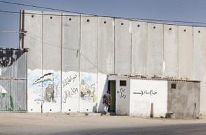 Palestinian Lives: A toilet by the wall barrier near to the crossing point into Egypt, Rafah