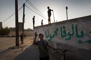 Palestinian Lives: Boys play in the Az Zurqa neighbourhood of Gaza City