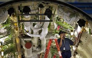 boeing 787 dreamliner: A Boeing employee works inside the fuselage