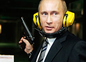 Vladimir Putin Gallery: 2006. Moscow, Russia: Russian President Vladimir Putin stands with a gun
