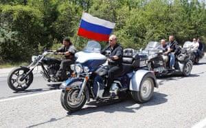 Vladimir Putin Gallery: 2010. Crimea, Ukraine: Prime Minister Vladimir Putin rides Harley Davidson