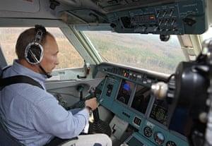 Vladimir Putin Gallery: 2010. Russia: Prime Minister Vladimir Putin sits in a cockpit
