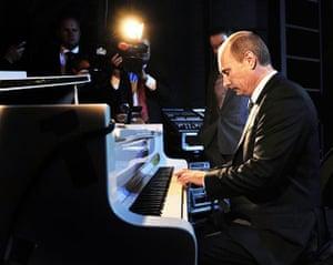 Vladimir Putin Gallery: 2011. Moscow, Russia: Prime Minister Vladimir Putin plays on a piano