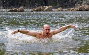 Vladimir Putin Gallery: 2009. Siberia, Russia: Prime Minister Vladimir Putin swims in a lake