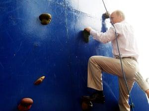 Vladimir Putin Gallery: 2011. Lake Seliger, Russia: Prime Minister Vladimir Putin on climbing wall