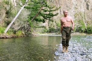Vladimir Putin Gallery: 2007. Siberia, Russia: President Vladimir Putin walks along Khemchik River