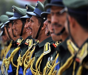 24 hours in pictures: Sana'a, Yemen: An army cadet yawns ahead of a military academy celebration