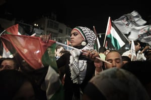 24 hours in pictures: Ramallah: Palestinians gather to watch live footage of Mahmud Abbas' speech