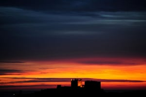 24 hours in pictures: Bamburgh, UK: The sun rises over Bamburgh Castle