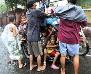 24 hours in pictures: Manila, Philippines: Residents arrive at an evacuation centre