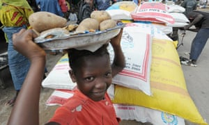 child sells food in Abidjan market