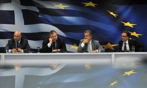 Greek finance minister Evangelos Venizelos and aides