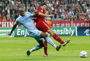 Champions League Tuesday: Manchester City's Vincent Kompany clears the ball from Bayern's Mario Gomez