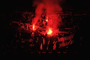 Champions League Tuesday: The Basel fans at Old Trafford light flares ahead of the match