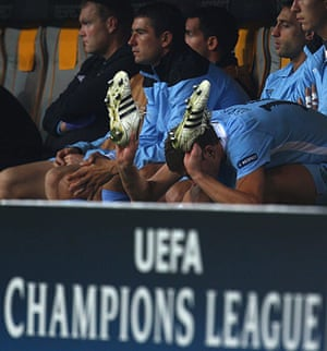 Champions League Tuesday: A frustrated Eden Dzeko bashes his boots in frustration after being subbed