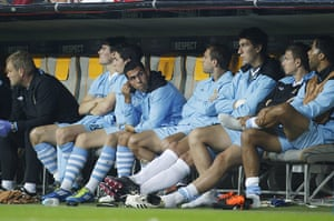 Champions League Tuesday: Manchester City's Carlos Tevez sits on the substitutes bench