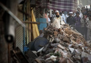 24 hours in pictures: building collapse in New Delhi, India