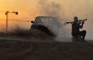 24 hours in pictures: A rebel fighter fires a rocket-propelled grenade in Libya