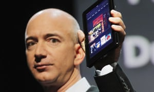 Amazon founder Jeff Bezos holds the new Amazon Kindle Fire