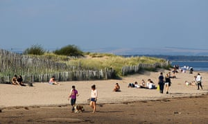 Hot weather in the UK: People enjoy the unseasonable weather conditions, St Andrew Beach, Scotland