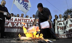 Greek protesters burning emergency tax notices