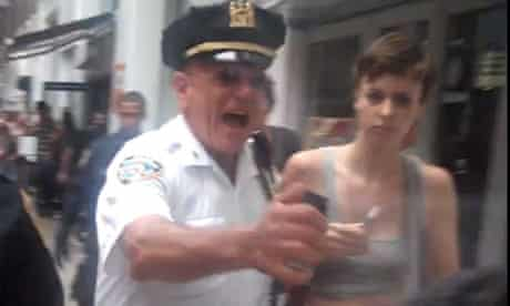 Anthony Bologna, a New York police officer, firing pepper spray at protesters
