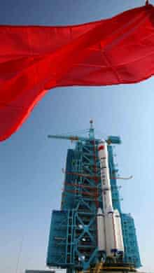 A Long March 2F rockey carrying China's Tiangong-1 space station module is awaiting lift-off