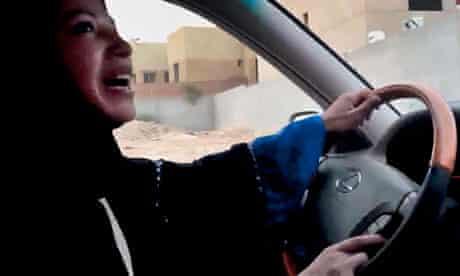 A woman drives a car in Riyadh as part of a campaign to defy Saudi Arabia's ban on women driving