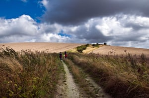 Hot Weather in the UK: People walking on the South Downs, West Sussex