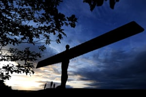 Hot Weather in the UK: The sun sets over the Angel Of The North in Gateshead