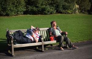 Hot Weather in the UK: People relax in the sunshine in a Garden in Regents Park