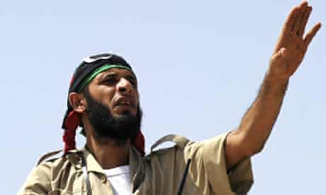 A National Transitional Council fighter mans a checkpoint on the road to Bani Walid