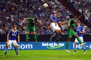 Europa League: Schalke's Joel Matip outjumps the Maccabi Haifa defence