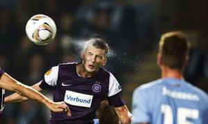 Europa League: Austria Vienna's Alexander Gorgon heads the ball against Malmo