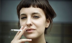 Young woman smoking.