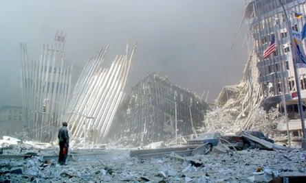 A man stands in the rubble of the World Trade Centre following the al-Qaida attacks